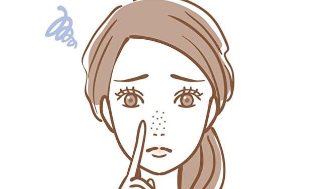 いちご鼻になった女性のイラスト